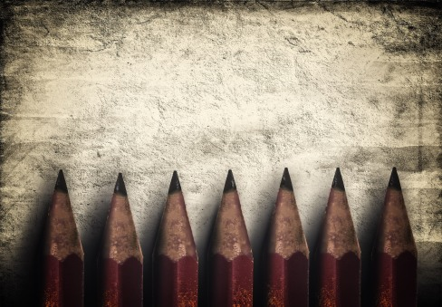 Illustration of vintage style red pencils over rough background